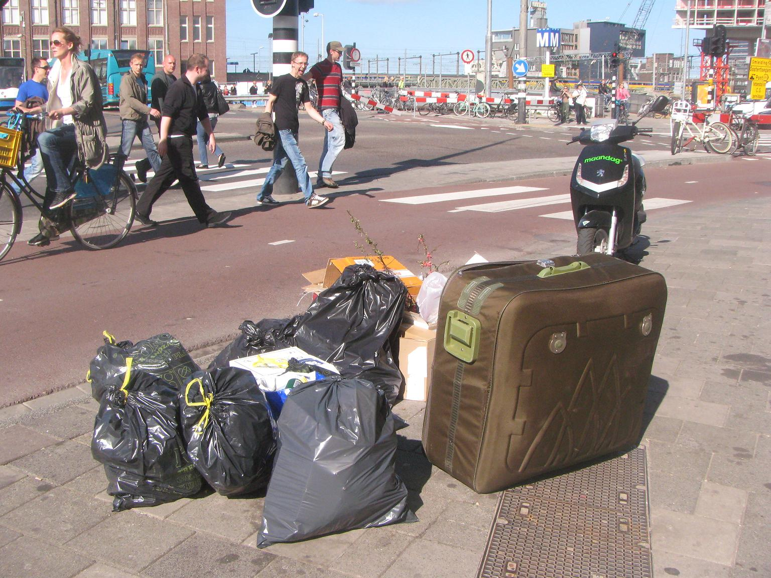 Mystery suitcase on street in garbage in Amsterdam